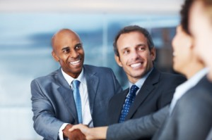 Successful business man greeting a colleague during a meeting